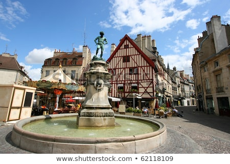 Famous fountain, characteristic houses and colorful carousel in  Stock photo © meinzahn