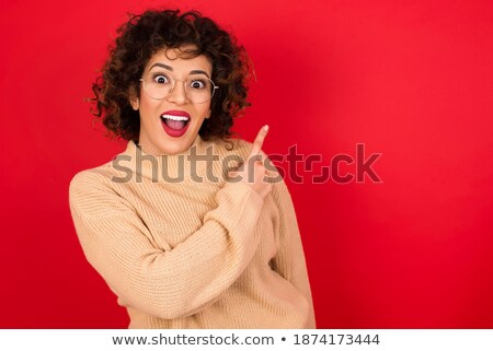 surprised charming african american young woman standing and looking away stock photo © deandrobot