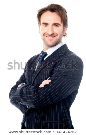 Mosolyog fiatal üzletember pózol keresztbe tett kar kép Stock fotó © deandrobot