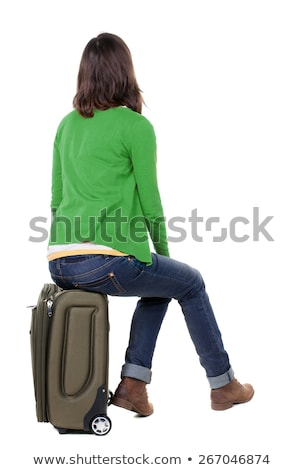 Stock photo: Young woman sitting on luggage waiting to go for a vacation