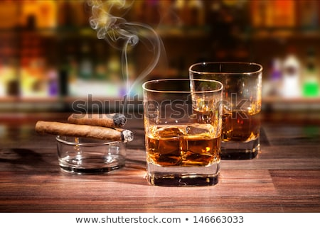 Whiskey with ice and cigar Stock photo © karandaev