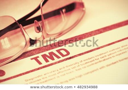 TMD - Printed Diagnosis on Red Background. 3D Illustration. Stock photo © tashatuvango