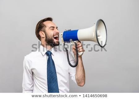Caucasian businessman talking into loudspeaker. Stock photo © RAStudio