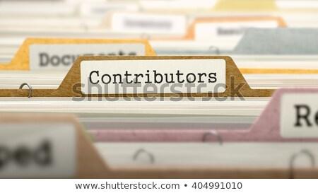 Contributors Concept on File Label. Stock photo © tashatuvango