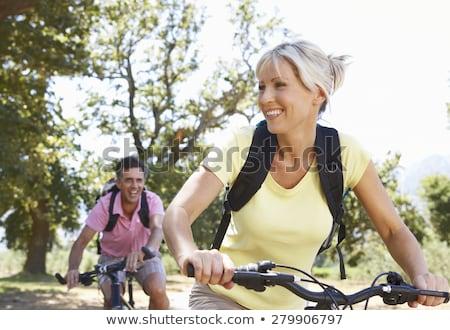 Kadın bisiklete binme doğa alan bisiklet Stok fotoğraf © IS2