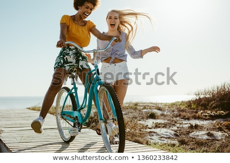 Woman with Bicycle on Boardwalk Stock photo © iofoto