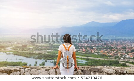Woman looking at ruined buildings Stock photo © IS2