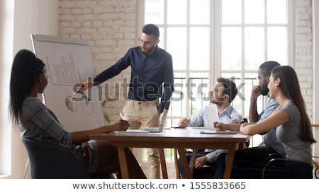 Arabic businesswoman showing financial diagram stock photo © studioworkstock