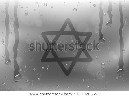 star of David sign draw on rainy window Stock photo © romvo