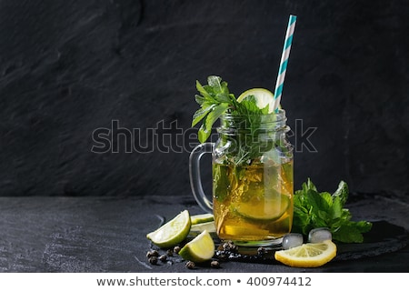 Fresh lemon over black Stock photo © deandrobot