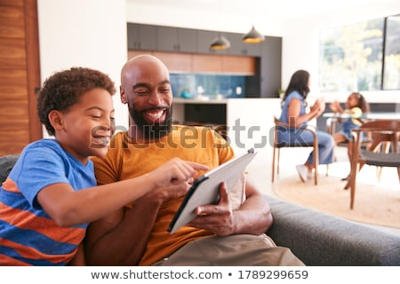 Father filming sons playing Stock photo © IS2