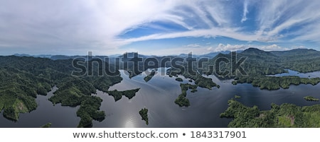 Landscape with a boat in the fjord and a waterfall in the mounta Stock photo © Kotenko