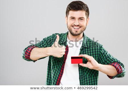 Hand showing green card Stock photo © Dinga