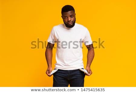 Człowiek pusty kieszeni widoku strony Zdjęcia stock © AndreyPopov