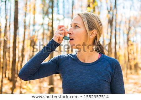 A Fitness running woman in winter season with asthma Stock photo © Lopolo