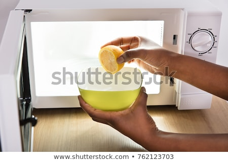 Woman Putting Sliced Lemon In Bowl Stock photo © AndreyPopov