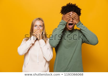 Photo of outraged couple man and woman 16-18 with dental braces  Stock photo © deandrobot