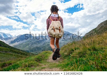 Scout girl with backpack Stock photo © bluering