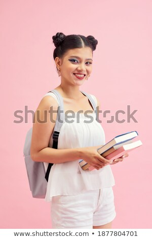 photo of pretty young woman with double buns hairstyle smiling a stock photo © deandrobot