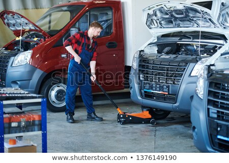 Putting cart under car Stock photo © pressmaster