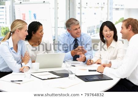 multi ethnic business people having business meeting stock photo © andreypopov