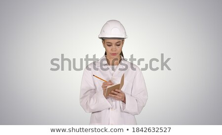 Green Checklist And Hard Hat On White Background Stock photo © AndreyPopov