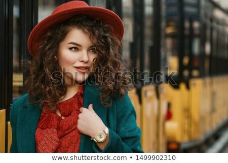 Beautiful plus size curly young brunette woman posing on white Stock photo © dashapetrenko