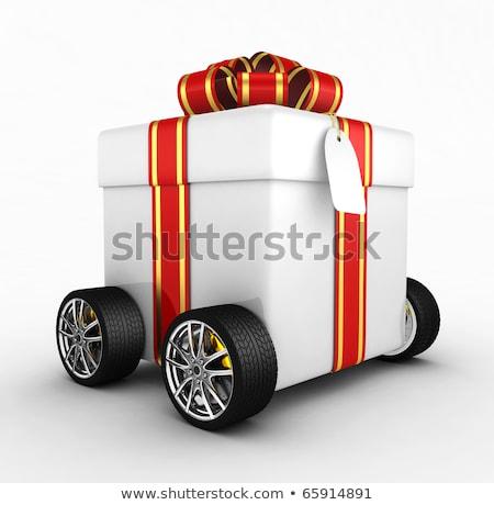 gift box with wheel on white background isolated 3d illustratio stock photo © iserg