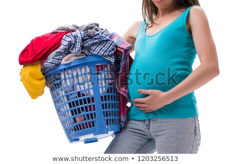 Woman holding basket of dirty clothing requiring washing Stock photo © Elnur