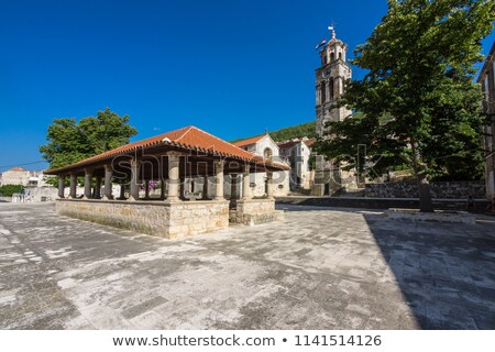 blato on korcula island historic stone square and church view stock photo © xbrchx