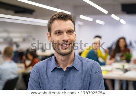 Optimistic businessman contemplating in office. stock photo © lichtmeister