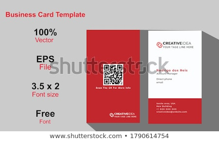 indian businessman with business card at office stock photo © dolgachov