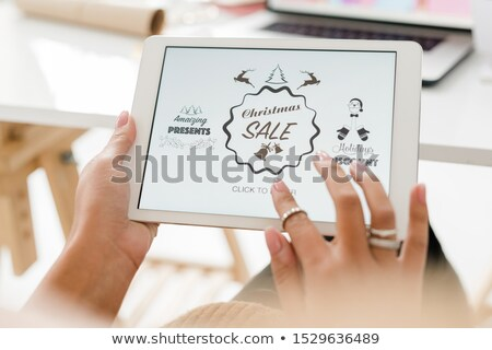 Hands of female customer over touchpad display going to enter online shop Stock photo © pressmaster