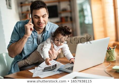 férfi · dolgozik · otthon · ül · kanapé · kandalló - stock fotó © nyul