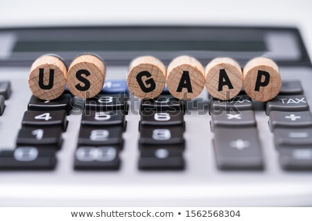 Wooden Blocks With US GAAP Text On Calculator Stock photo © AndreyPopov