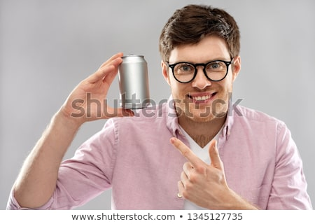 Foto stock: Happy Young Man Holding Tin Can With Soda
