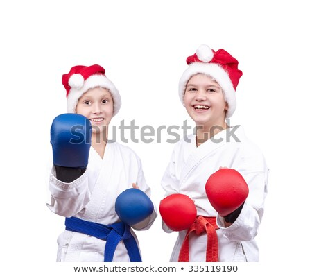 In caps of Santa Claus and with overlays on hands the athletes stand in rack Stock photo © Andreyfire