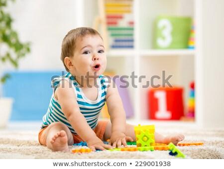 Boldog baba fiú építőkockák szőnyeg otthon Stock fotó © dolgachov