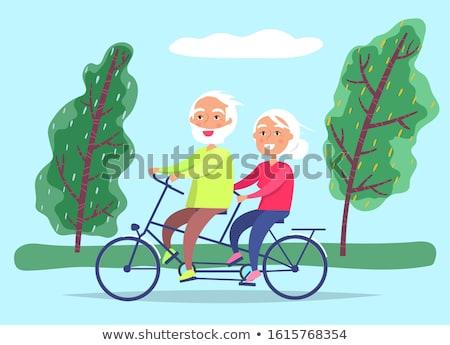 Ancianos Pareja bicicleta fecha abuelos equitación Foto stock © robuart