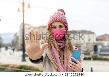 женщину маске знак остановки камеры город Сток-фото © Kzenon