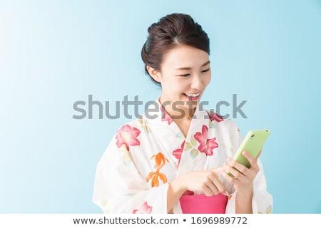 Japanese Woman Wearing Kimono Geisha with Cell Stock photo © robuart