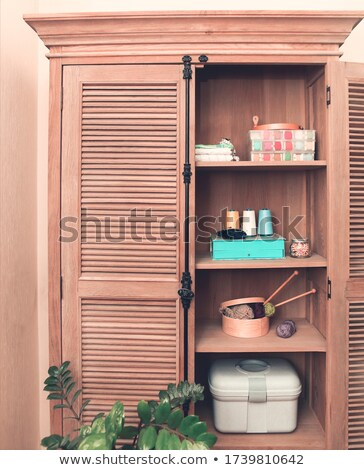 Sewing accessories in retro wooden cupboard Stock photo © dashapetrenko