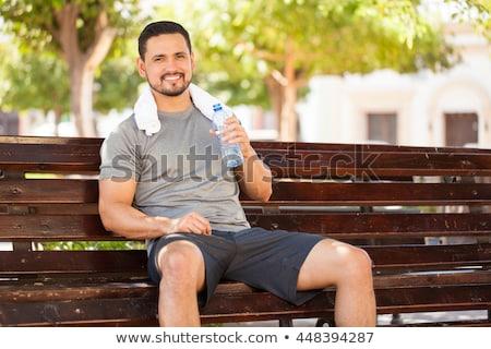 Imagen jóvenes fuerte hombre agua potable Foto stock © deandrobot