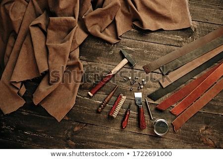 Kézzel készített gyártás bőr áru férfi dolgozik Stock fotó © olira
