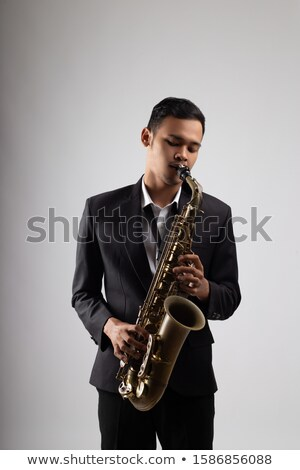 young man playing saxophone Stock photo © yupiramos
