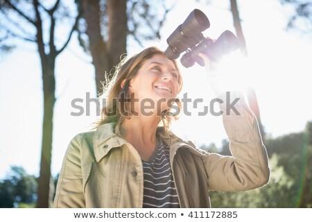 Mulher assistindo binóculo símbolo céu nuvens Foto stock © deyangeorgiev