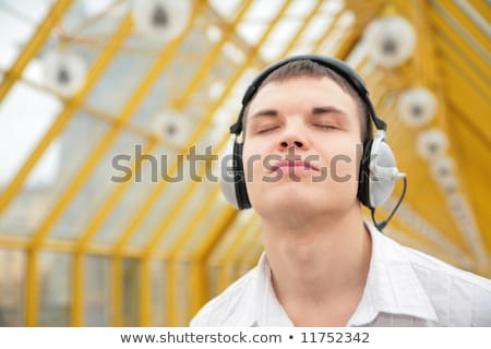 young man listens music on footbridge Stock photo © Paha_L