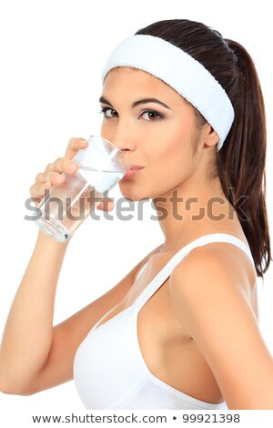 Stock photo: smiling young woman with water isolated over white background