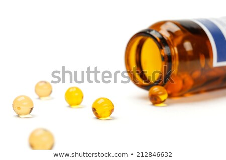 Yellow Medicine Bottles With Pills. Isoated stock photo © iofoto