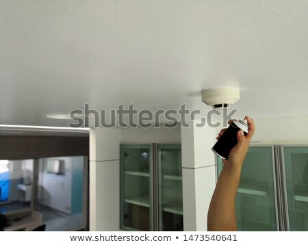 Hand holding a smoke alarm Stock photo © photography33